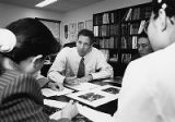 Robert J. Alpern, M.D., with students in office, 1998